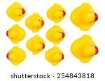 Small photo of Yellow rubber ducks in a row. An individualist is sticking out the crowd