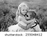 Two Little Girls Hugging On A...
