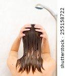 female washing hair | Shutterstock . vector #255158722