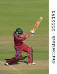 A cricket batsman in action - stock photo