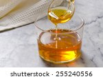agave syrup pouring on a glass. ...   Shutterstock . vector #255240556