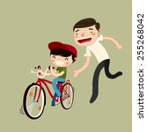 father teaches son to ride a... | Shutterstock .eps vector #255268042