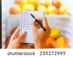 checking shopping list. close... | Shutterstock . vector #255272995