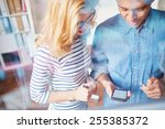 two co workers using smartphone ... | Shutterstock . vector #255385372