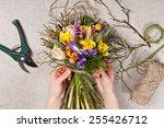 hands of florist making bouquet ...   Shutterstock . vector #255426712
