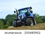 A Stationary Blue Tractor Is...