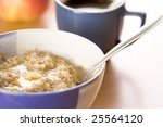 Hot morning porridge with spoon - stock photo