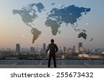 businessman stand on roof top... | Shutterstock . vector #255673432