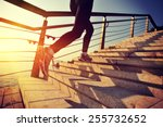 Stock photo healthy lifestyle sports woman running up on stone stairs sunrise seaside 255732652