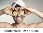 man with a mud mask on this face   Shutterstock . vector #255770686