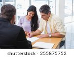 smiling couple signing a... | Shutterstock . vector #255875752
