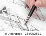 architect hand drawing house...   Shutterstock . vector #256003582