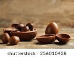 Chocolate Easter Eggs On Wooden ...
