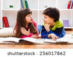 little girl and little boy have ... | Shutterstock . vector #256017862