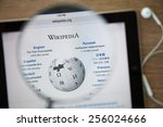 Small photo of CHIANGMAI, THAILAND - February 26, 2015: Photo of Wikipedia homepage on a ipad monitor screen through a magnifying glass.