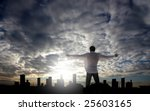 Man With Open Arms Facing A...