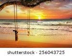 Empty Swing At Sunset Beach
