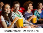 young couple watching a film at ... | Shutterstock . vector #256045678