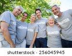 happy volunteer family smiling...   Shutterstock . vector #256045945