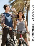 thirsty young couple on... | Shutterstock . vector #256047706