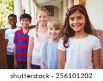 Small photo of Portrait of smiling little school kids in school corridor