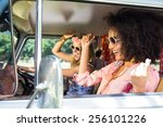 happy friends on a road trip on ... | Shutterstock . vector #256101226
