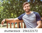 young man relaxing on park... | Shutterstock . vector #256122172
