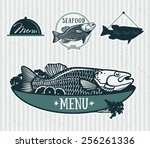 cooked fish and raw vegetables...   Shutterstock .eps vector #256261336
