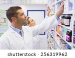 team of pharmacists looking at... | Shutterstock . vector #256319962
