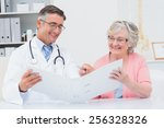 happy male doctor and female... | Shutterstock . vector #256328326