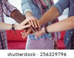 fashion students putting hands... | Shutterstock . vector #256329796