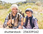 father and son hiking in the... | Shutterstock . vector #256339162