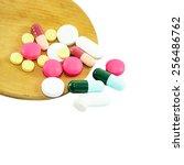 tablet pill on wood spoon... | Shutterstock . vector #256486762