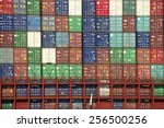 Small photo of OAKLAND, CA - FEBRUARY 26, 2015: The average container ship can hold 3,500 containers. Shipping containers are organized and placed algorithmically for efficient transport.