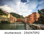 an old man sitting on a dock in ... | Shutterstock . vector #256547092
