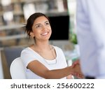 young woman shaking hands with... | Shutterstock . vector #256600222