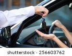 close up of car dealer giving... | Shutterstock . vector #256603762