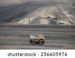 dump truck running at coal mining field,pingsuo,china - stock photo