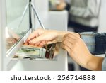 female hand with money in cash... | Shutterstock . vector #256714888