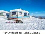 car caravan in winter, snow ice - stock photo