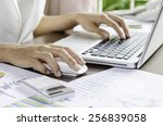 woman using a mouse working on... | Shutterstock . vector #256839058