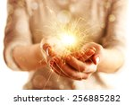 hands with sparkler light...   Shutterstock . vector #256885282