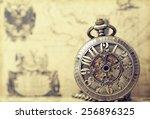 Vintage Clock On Antique Map....