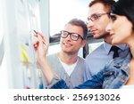 three colleagues standing in... | Shutterstock . vector #256913026