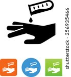 acid being spilled on a hand... | Shutterstock .eps vector #256935466