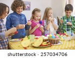 preparing for easter by group... | Shutterstock . vector #257034706