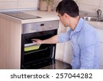 young man checking heat... | Shutterstock . vector #257044282