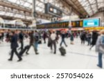 Small photo of Crowded station during rush hour in London, blurred background