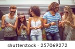 hipster friends using their... | Shutterstock . vector #257069272