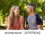 happy couple in the park on a... | Shutterstock . vector #257078242
